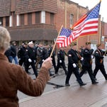 Veterans march and are honored during the annual Veterans Day Parade and ceremonies in St. Johns in this Lansing State Journal file photo from Veterans Day 2014. Legislation meant to help veterans advanced Thursday in the Legislature.