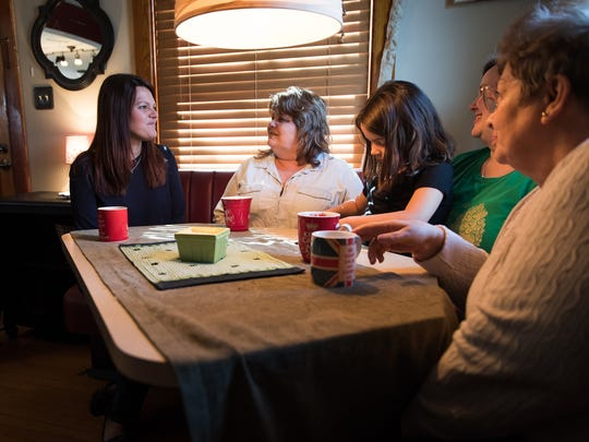 Heather Hazel, left, shares the booth she once sat in with her father. She's with, from left, DiAnn Edwards, Brigid Hazel, Heidi Baylor-Thatcher, and Jeanette Miller in Hazel's Gettysburg home.