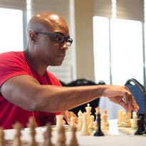 Joseph Dean contemplates his next move during the Great Lakes Chess Open Friday evening at McCamly Plaza.