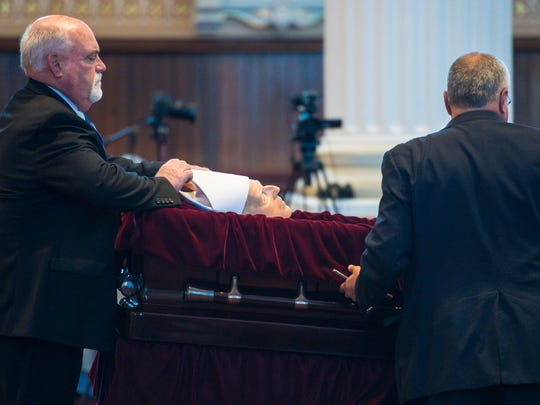 Staffers from LaVigne Funeral Home prepare to close the casket before funeral services for Bishop Emeritus Kenneth Angell at St. Joseph's Co-Cathedral in Burlington on Tuesday, October 11, 2016.