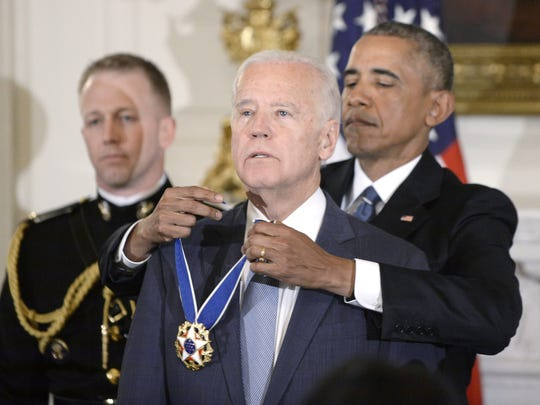 Jan. 12, 2017: President Barack Obama (right) presents the Medal of Freedom to Vice President Joe Biden during an event in the State Dining Room of the White House in Washington.