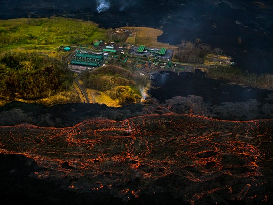 Lava from the Kilauea volcano flows near the Puna Geothermal Venture power plant on June 10, 2018, in Pahoa, Hawaii.