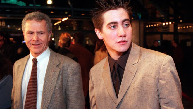 """Author Homer Hickam, left, who wrote the book """"Rocket Boys"""" among others, and Jake Gyllenhaal, the actor who plays Hickam in the film version of the book, called """"October Sky,"""" pose at the premiere of the film in Universal City, Calif., in this Feb. 11, 1999 file photo."""