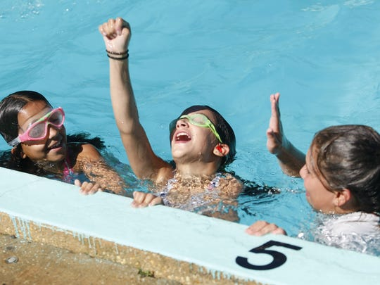 Three girls celebrate during a charity swimming event at the Monmouth Day Camp in 2012.