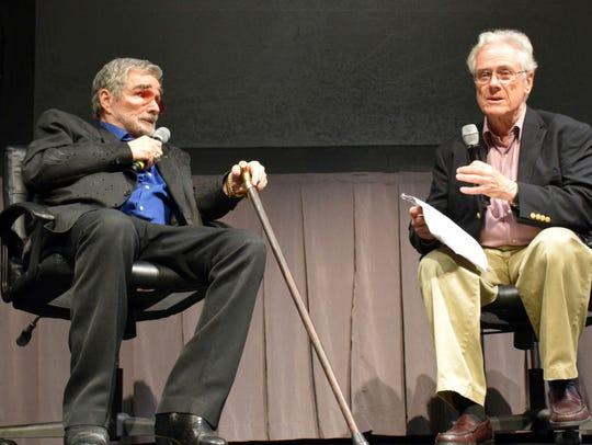 Jeffrey Lyons, right, interviews Burt Reynolds at opening
