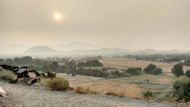 Reader Craig Ayres-Sevier shared this photo of haze over downtown Reno as seen from Windy Hill on Friday, Aug. 21, 2015.