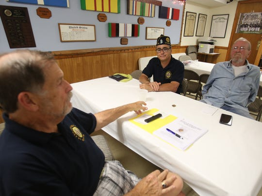 From left, Local veterans Jim Leiner, Anthony DelRegno and Jerry Donnellan discuss how to find the owner of a Purple Heart that was found in the woods in Rockland County, during a meeting at American Legion Post in Nyack July 13, 2017.