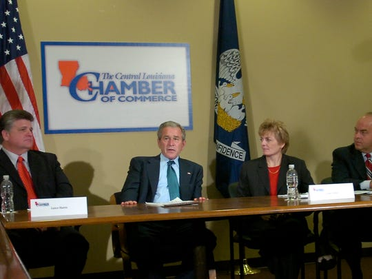 President George W. Bush (center) talked with area business officials during a roundtable discussion on the economy at the Central Louisiana Chamber of Commerce office in Alexandria in 2008.