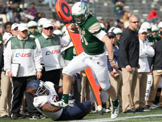 UAB Blazers quarterback A.J. Erdely carries the ball against UTEP Miners during the first quarter at Legion Field.