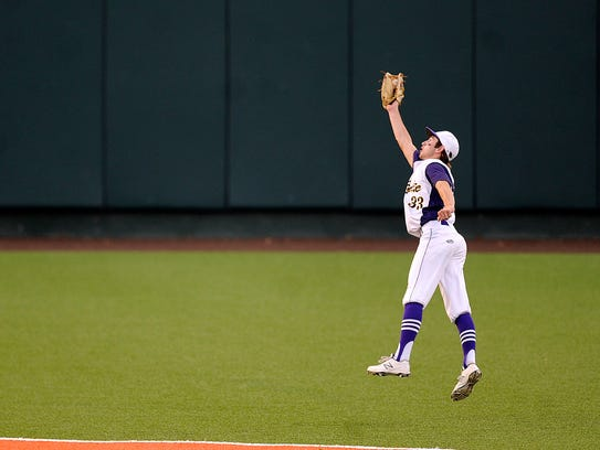 Wylie center fielder Sam King (33) makes a leaping