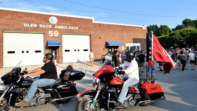 Ten minutes before the Glen Rock borough council meeting, bikers ride past in support of a public, nightly broadcast of 'Taps.'