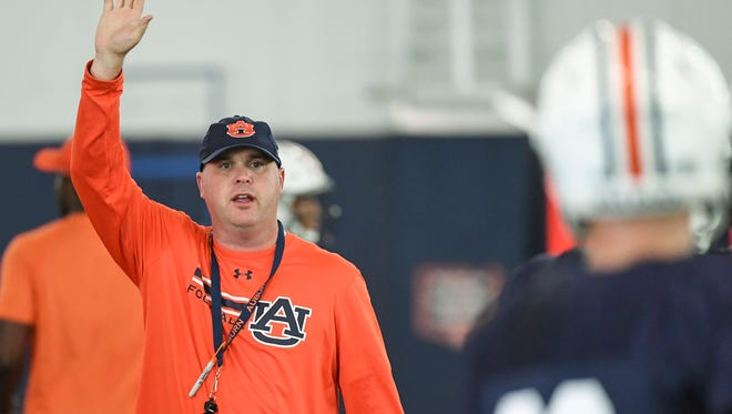 Auburn offensive coordinator Chip Lindsey raises his hand during a preseason practice on Aug. 2, 2017.