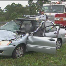 The man driving this car was killed when a tire flew off a truck and crashed through the windshield.