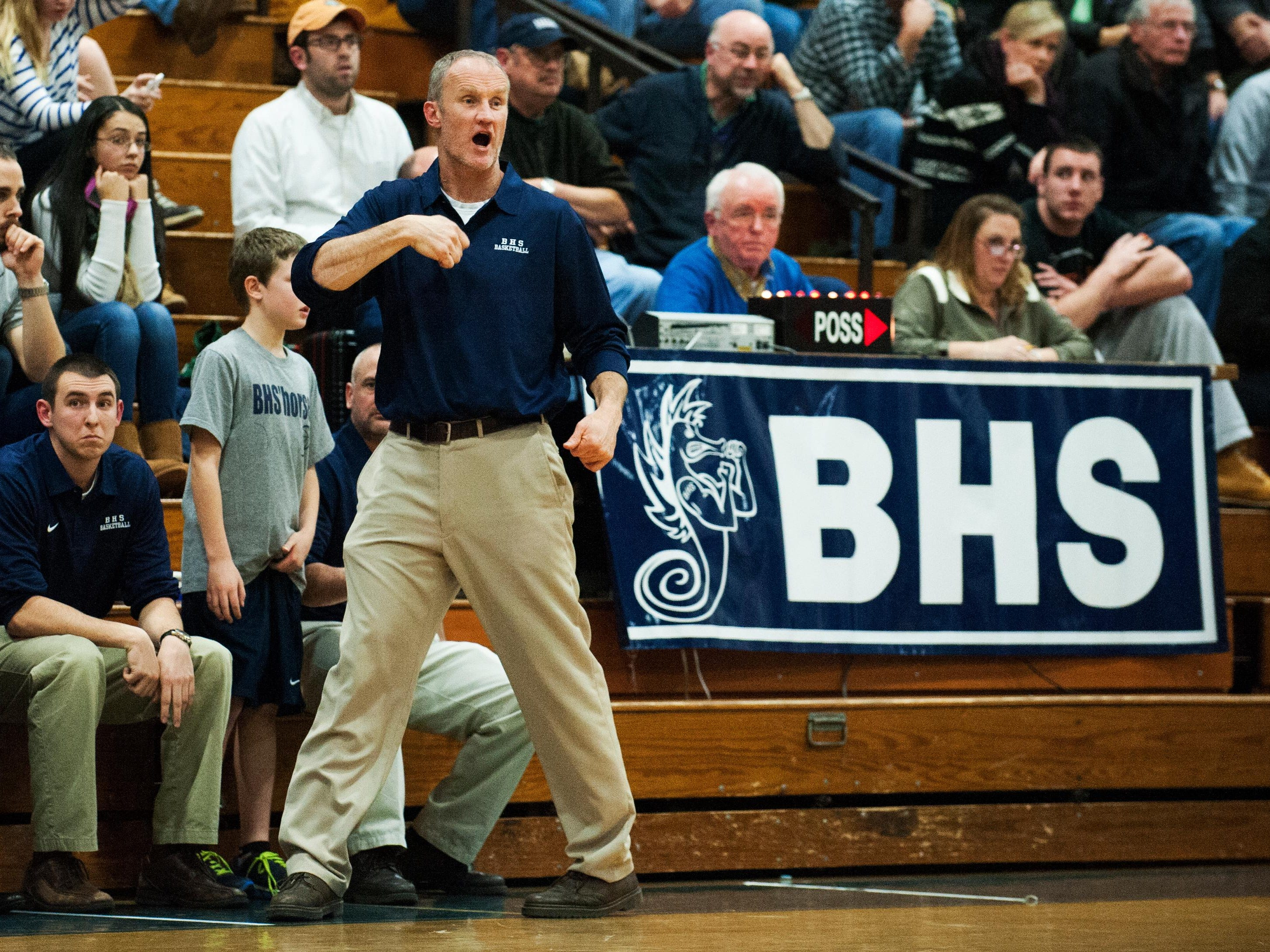 Burlington head coach Matt Johnson talks to his tema on the court during the boys basketball game between the Rice Green Knights and the Burlington Seahorses at BHS high school on Tuesday night December 9, 2014 in Burlington, Vermont. (BRIAN JENKINS, for the Free Press)