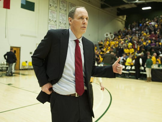 Vermont head coach John Becker breathes a sigh of relief at the conclusion of the America East men's basketball semi final playoff game between the New Hampshire Wildcats and the Vermont Catamounts at Patrick Gym on Monday night March 7, 2016 in Burlington. (BRIAN JENKINS/for the FREE PRESS)