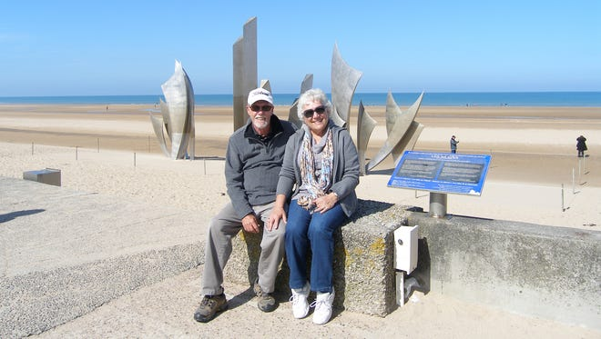Mike and Michelle Moore of Phoenix at Omaha Beach in France.