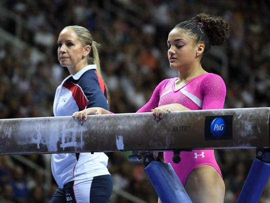 July 10, 2016; San Jose, CA, USA; Laurie Hernandez (right), from Old Bridge, NJ, prepares to compete as Maggie Haney (left) looks on during the balance beam in the women's gymnastics U.S. Olympic team trials at SAP Center. Mandatory Credit: Kyle Terada-USA TODAY Sports