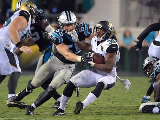FILE - In this Aug. 24, 2017, file photo, Carolina Panthers linebacker David Mayo (55) tackles Jacksonville Jaguars running back Corey Grant (30) at the line of scrimmage during the second half of an NFL preseason football game in Jacksonville, Fla. For the third time in three years, the Panthers have to find a way to replace Luke Kuechly because of a concussion. Only this time, they don't have A.J. Klein to turn to. He signed with the Saints as a free agent meaning its David Mayo's turn to anchor the defense. (AP Photo/Phelan M. Ebenhack, File)