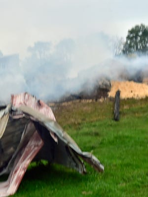An early morning fire on Saturday October 21, 2017 completely distroyed a barn used to store hay at Windy Knoll View Farm at 8656 Corner Road, Mercersburg. Other barns on the property were not affected by the fire. Some of the hay was still smoldering on Monday morning.