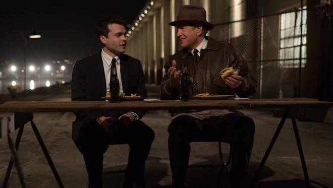 Frank (Alden Ehrenreich) and Howard Hughes (Warren Beatty) share hamburgers in 'Rules Don't Apply.'