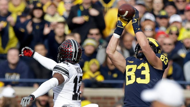 Michigan tight end Zach Gentry catches a pass defended by Ohio State cornerback Denzel Ward in the first half Saturday, Nov. 25, 2017 in Ann Arbor.