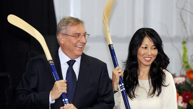 In this 2013 file photo, Buffalo Sabres owner Terry Pegula and his wife, Kim Pegula, pose for cameras during groundbreaking ceremonies at First Niagara Center.