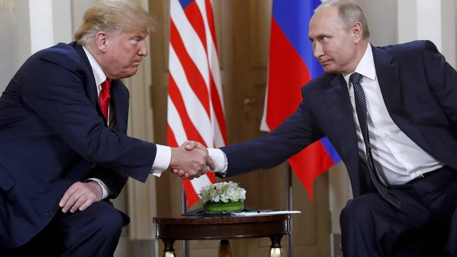 In this file photo taken on Monday, July 16, 2018, President Donald Trump, left, and Russian President Vladimir Putin shake hands at the beginning of a meeting in Helsinki, Finland. The White House on Thursday rejected a Democratic request for information on private conversations between Trump and Putin, including an interview with an interpreter who sat in on their one-on-one meeting in Helsinki last summer.