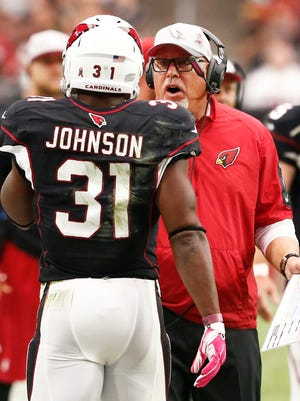 Arizona Cardinals  coach Bruce Arians questions David Johnson after a failed pass play at the end of the second quarter against the St. Louis Rams on Oct. 4, 2015 in Glendale.
