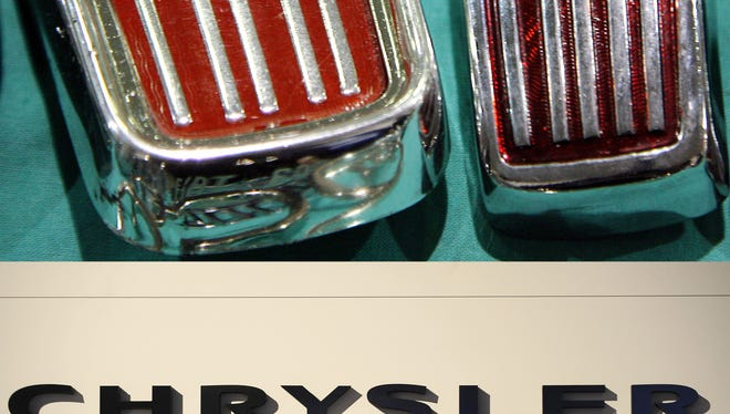 Chrysler and Fiat logos symbolize a combined company now that Fiat hasa purchased all of the Detroit automaker.