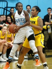 Aaliyah Staples-West, left, of Buena looks to pass as Ventura's Kenya Henderson defends Tuesday night at Buena High.