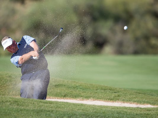 Colin Montgomerie digs himself out of a sand trap at the Charles Schwab Championship at Desert Mountain, Sunday, Nov. 2, 2014, in Scottsdale, Ariz. (AP Photo/The Arizona Republic, Dominic Valente)  MARICOPA COUNTY OUT; MAGS OUT; NO SALES