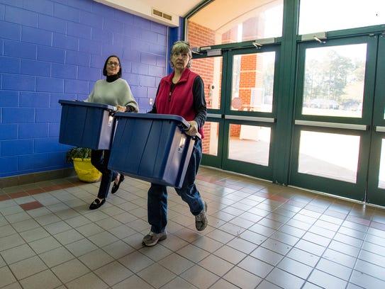 Nelya McKenzie, right, and Nancy Jo Brown, left, deliver