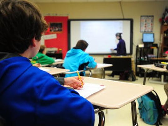 A Lafayette Parish teacher leads a classroom lesson in 2015. A new study ranks Louisiana as the 40th state for teachers.