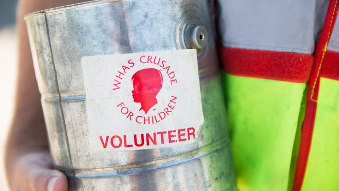 Thomas Lyon, a fire fighter of 4 years, volunteers collecting money for WHAS Crusade for Children. Every year during the crusade season fire fighters collect 5 days a week. June 2, 2017.
