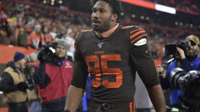 Cleveland Browns defensive end Myles Garrett walks off the field after he was ejected late in the fourth quarter of an NFL football game against the Pittsburgh Steelers, Thursday, Nov. 14, 2019, in Cleveland. The Browns won 21-7.