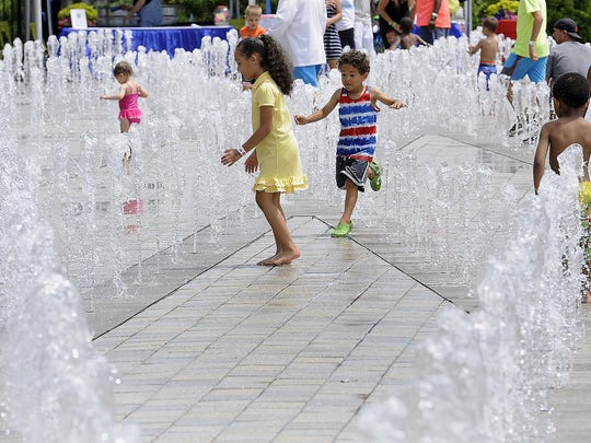 Some children play at the fountains during the 8th Annual River Days held at the Detroit River Walk on Sunday.