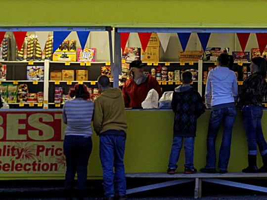 Customers line up to buy fireworks in this Tribune file photo.