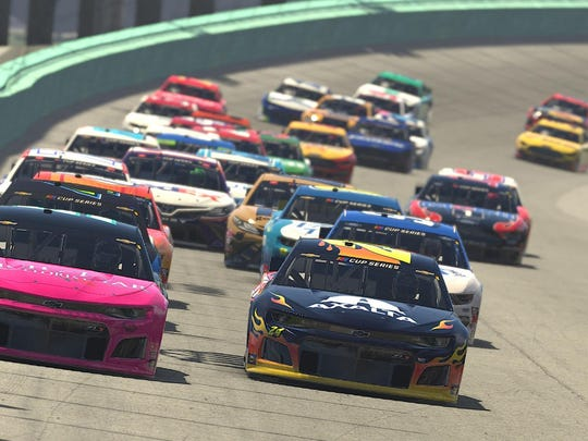 In an image that was computer generated in-game, Garrett Smithley, driver of the No. 51 Chevrolet, leads the field at the start of the eNASCAR iRacing Pro Invitational Series Dixie Vodka 150 at virtual Homestead-Miami Speedway on March 22, 2020, in Homestead, Fla. (Chris Graythen/Getty Images/TNS)