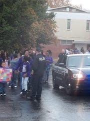 People came together in East Jackson Saturday for the first ever Domestic Violence Walk held in honor of Mary Ann Greer, a domestic abuse survivor who spent four months at The Med.