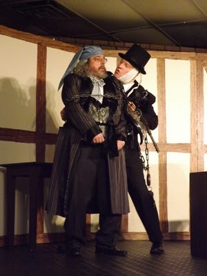 """Scrooge (Matthew Socey) is frightened by the visit of Jacob Marley (Jack Werle) in a rehearsal of """"A Christmas Carol"""" at Centerville Christian Church's Family Center."""