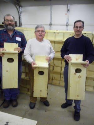 Local conservationists gathered to build wood duck and bluebird houses in Bob Schuh's shop. Bill Mecha (from left) of the Maribel Sportsmen's Club, Glen Pfeffer of the Izaak Walton League of America-Manitowoc Chapter and Dennis Musil of the Francis Creek Sportsmen's Club (Jim Koch is not pictured) show some of the wood duck houses they built.