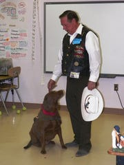 Service and emotional support dog Mowie visited a White Mountain Elementary school 5th grade class with owner John McIntire.