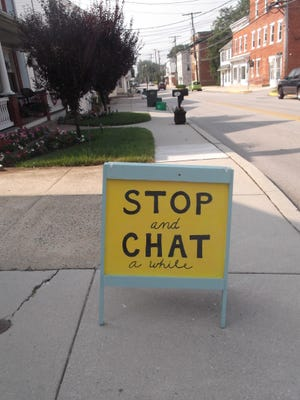 Jenni Sipe uses this sign outside her home on North Main Street in Stewartstown to encourage passersby to stop and talk. She thinks it's important for people connect face-to-face rather than electronically via cell phones.