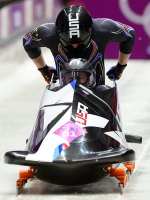 USA-1 piloted by Steven Holcomb with Steven Langton begins its third run in two-man bobsled.