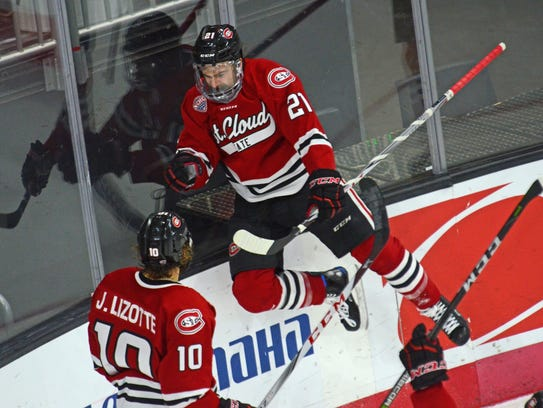 ST. Cloud State's Jake Wahlin (21) celebrates his goal