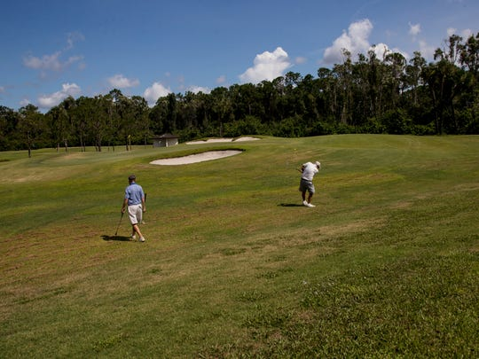Golfers Jack Tilson and Tom Taggart play the 13th hole