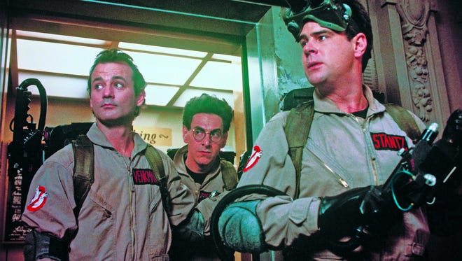 """Bill Murray, Harold Ramis and Dan Aykroyd in a scene from the 1984 motion picture """"Ghostbusters."""""""