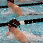 York Suburban swim teams sweep Dover