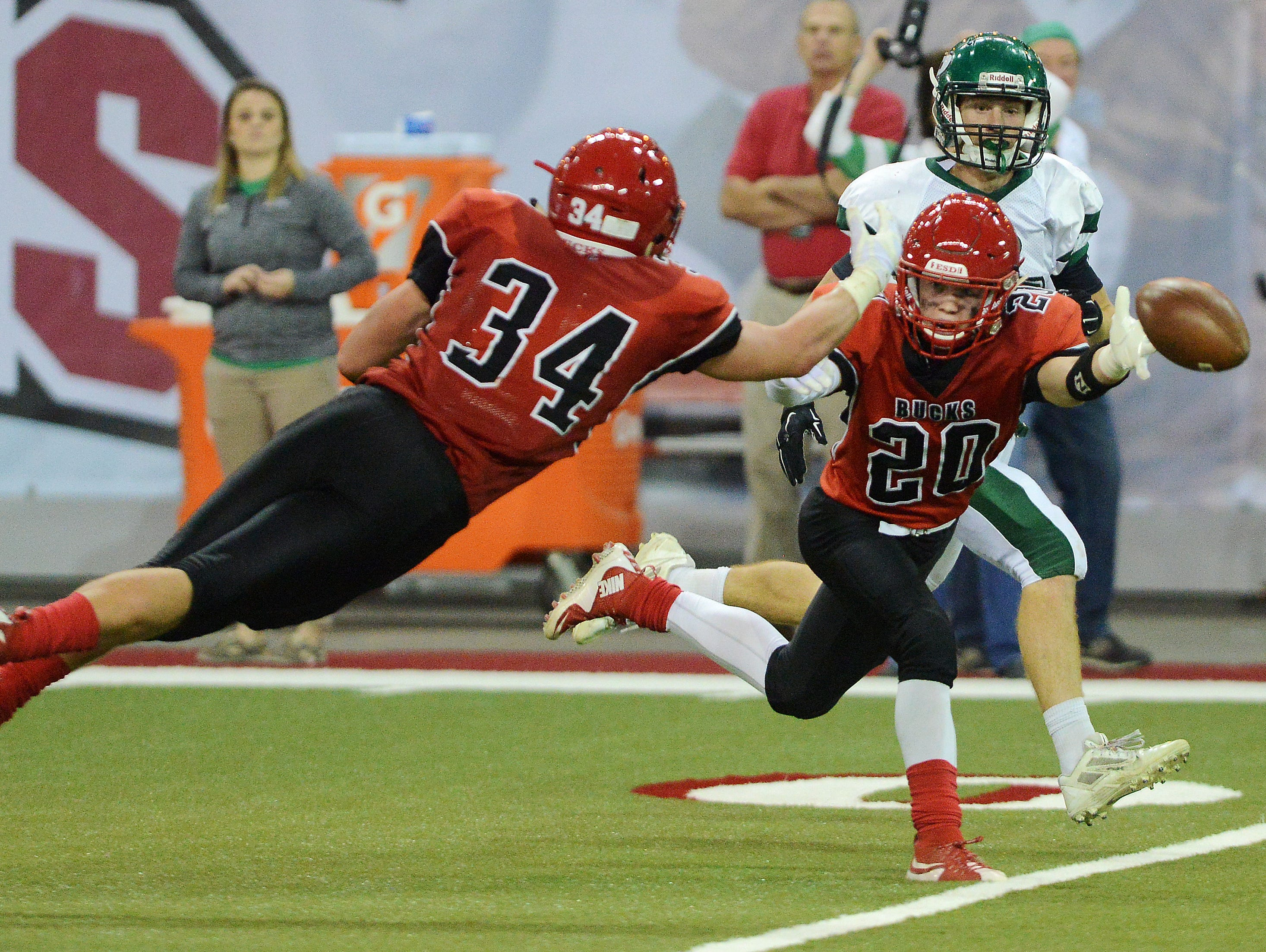Yankton's Sheldon Gant and Tanner Frick dive for a pass during the Class 11AA championship. Gant and Frick were two of five Yankton seniors named to the Class 11AA All-State team.