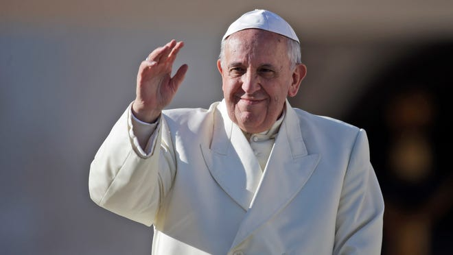 Pope Francis arrives in St. Peter's Square for the weekly general audience on Dec. 4 at the Vatican.